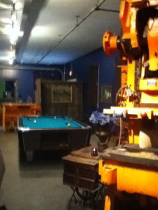Pool table on the upper level, just around the corner from the main entrance.